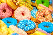 Various decorated doughnuts. Blue and pink donuts. Sweet icing sugar food. Dessert colorful snack. G poster