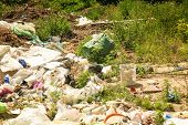 Garbage and wastes at spontaneous dump poster