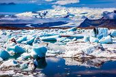 Morning light in the Ice Lagoon. Drift ice Ice Lagoon - Jokulsarlon. Icebergs and ice floes are refl poster