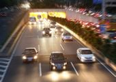 Night traffic, cars on highway road on sunset evening night in busy city poster