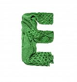 Knitting alphabet. Letter of knit handmade alphabet on white background. Letter E of knit handmade a poster
