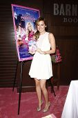 LOS ANGELES - APR 19:  Ashley Tisdale attends a DVD signing for 'Sharpay's Fabulous Adventure!' at B