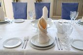 Table With White Plate, Crystal Wineglasses, Linen Beige Napkin And Cutlery On Tablecloths, Free Spa poster