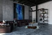 A modern, contemporary, industrial style polished concrete living room interior with leather lounges poster