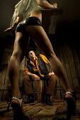 foto of take off clothes  - Young Cowboy looking at woman taking off her clothes against wooden background - JPG