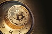 Safe lock with symbol of bitcoin. Bitcoin cryptocurrency security and protection of anonymity concep poster