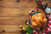 Christmas or Thanksgiving turkey on rustic wooden table poster