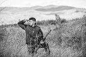 Bearded Hunter Spend Leisure Hunting. Hunter Hold Rifle. Focus And Concentration Of Experienced Hunt poster