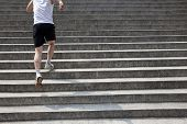 foto of upstairs  - a healthy running man up to stairs - JPG