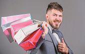 Elite Boutique. Man Bearded Elegant Businessman Carry Shopping Bags On Grey Background. Make Shoppin poster