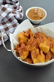 Deep Fried Crispy Wontons Served With Peanut Sauce poster