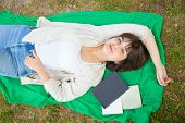 Happy Carefree College Girl Enjoying Break In Campus Area Outdoors. Top View Of Peaceful Young Woman poster