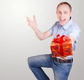 Expressive Young Man With Gift Box