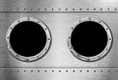 picture of ironclad  - two metal ship portholes - JPG