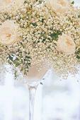 Pale Creamy Rose And Gypsophila Floral Wedding Decor In Elegant Glass Vase. Pastel Vintage Toning Fo poster