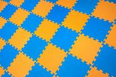 Rubber Orange-blue Colored Floor Puzzle. Horizontal Layout Perspective. Flooring Indoors Playground. poster