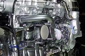 stock photo of internal combustion  - Closeup of engine of an automobile - JPG