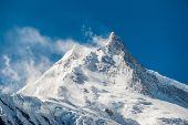 View Of Snow Covered Peak Of Mount Manaslu (8 156 Meters) With Clouds In Himalayas, Sunny Day At Man poster