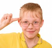 stock photo of imbecile  - Boy twist by finger near temple - JPG