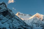 View Of Snow Covered Peak Of Mount Manaslu During Sunrise (8 156 Meters) With Clouds In Himalayas, S poster