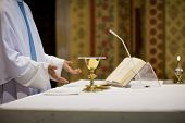 stock photo of eucharist  - Priest during a wedding ceremony - JPG