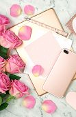 Ultra Feminine Pink Desk Workspace With Rose Gold Accessories Flatlay. poster