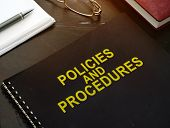 Policies And Procedures Company Documents On A Desk. poster