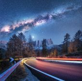 Milky Way Over Mountain Road. Blurred Car Headlights On Winding Road In Autumn. Beautiful Night Land poster