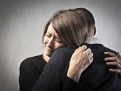 stock photo of tragic  - Sad woman hugging her husband - JPG