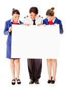 stock photo of cabin crew  - Airplane cabin crew holding banner  - JPG