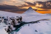 Kirkjufell Mountain With Waterfalls At Winter Sunrise, Iceland. poster