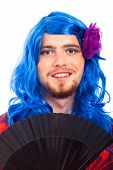 stock photo of cross-dressing  - Happy transvestite man cross dressing in blue wig isolated on white background - JPG