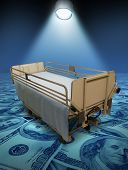 foto of stretcher  - Hospital care expenses and the high costs of medical inurance for surgery or medicine treatment represented by a stretcher on a blue floor of money and a spotlight shining on the bed - JPG