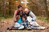 picture of biracial  - Happy family with foster children in the forest - JPG