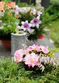 image of urn funeral  - Funeral flowers placed on the grave at All souls holiday - JPG