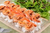 Spicy Prawn Skewers With Rice And Greens poster
