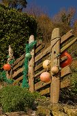 pic of driftwood fence  - driftwood fence with colored floats - JPG