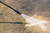 stock photo of water jet  - Floor cleaning with high pressure water jet - JPG