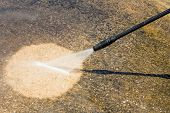 stock photo of pressure-wash  - Floor cleaning with high pressure water jet - JPG
