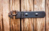 stock photo of hasp  - Rusty screw bolt on wooden door as lock  - JPG