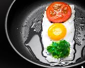 Original Breakfast Theme. Fried Egg With Tomato And Greens In Shape Of Traffic Light In A Frying Pan