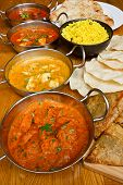 image of samosa  - Selection of indian curries with pilau rice naan bread poppadoms and samosas a popular buffet choice - JPG