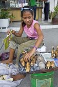 Young Girl Roasting Corn Philippines