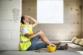 picture of accident emergency  - Construction worker has an accident while working on new house - JPG