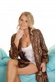 Woman Animal Print Robe Sit Blue Sheet Smile