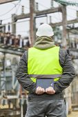 stock photo of substation  - Electrical Engineer with tablet PC in electrical substation - JPG
