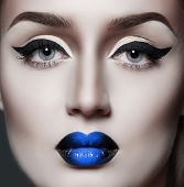 stock photo of evil queen  - fashion gothic woman with sexy blue lips - JPG