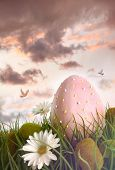 stock photo of tall grass  - Large pink egg with daisies in tall grass - JPG