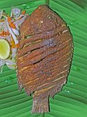 Постер, плакат: South Indian Thali meals With Fish Served Traditionally On Banana Leaf