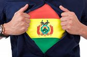 foto of south american flag  - Young sport fan opening his shirt and showing the flag his country Bolivia Bolivian flag - JPG